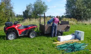 Delivering the fence energiser boxes and fence polyposts in preparation for grazing.